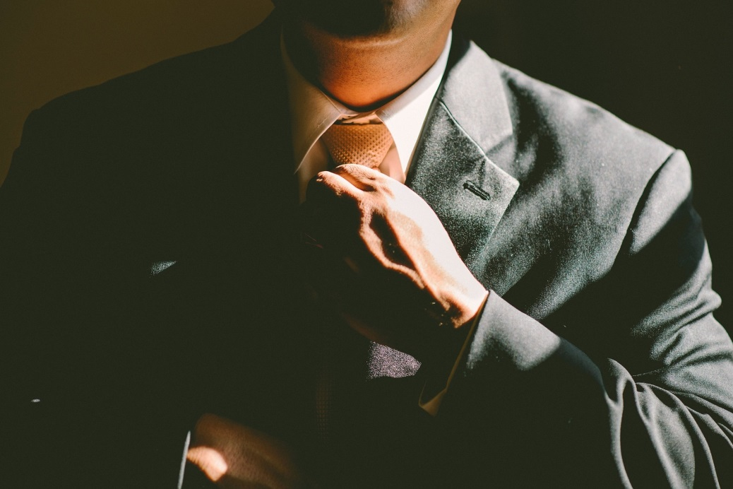10 Keys That a Young Entrepreneur Must Known to Survive in the Corporate World tying tie